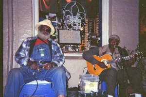 Grandpa Elliott (Elliott Small) and Stony B (Michael Stone) performing at a corner on Royal Street.