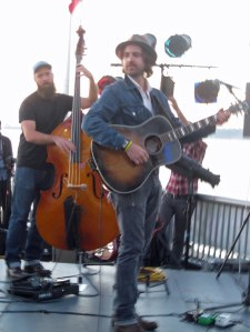 Bradley Laina, guitar, and Sander Vinberg, bass, go through a sound check prior to performing on the Seattle waterfront last summer.
