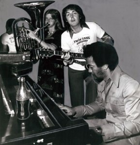 Linda and Paul McCartney performing with Allen Toussaint in his New Orleans studio in 1975.