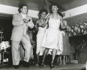 A dance contest for female impersonators at the Dew Drop Inn with Bobby Marchan  on stage. Ralston Crawford Collection,William Ransom Hogan Jazz Archive, Howard-Tilton Memorial Library, Tulane University