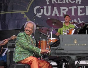 Allen Toussaint looking over his shoulder at a Paddlewheeler cruising the Misssissippi while performing at French Quarter Festival this year. He'll be playing by the Willamette River this Friday.