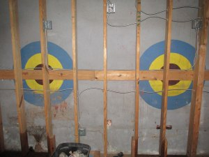 Frank Painia had a practice of painting bull's eye targets behind the stage at the Dew Drop Inn.